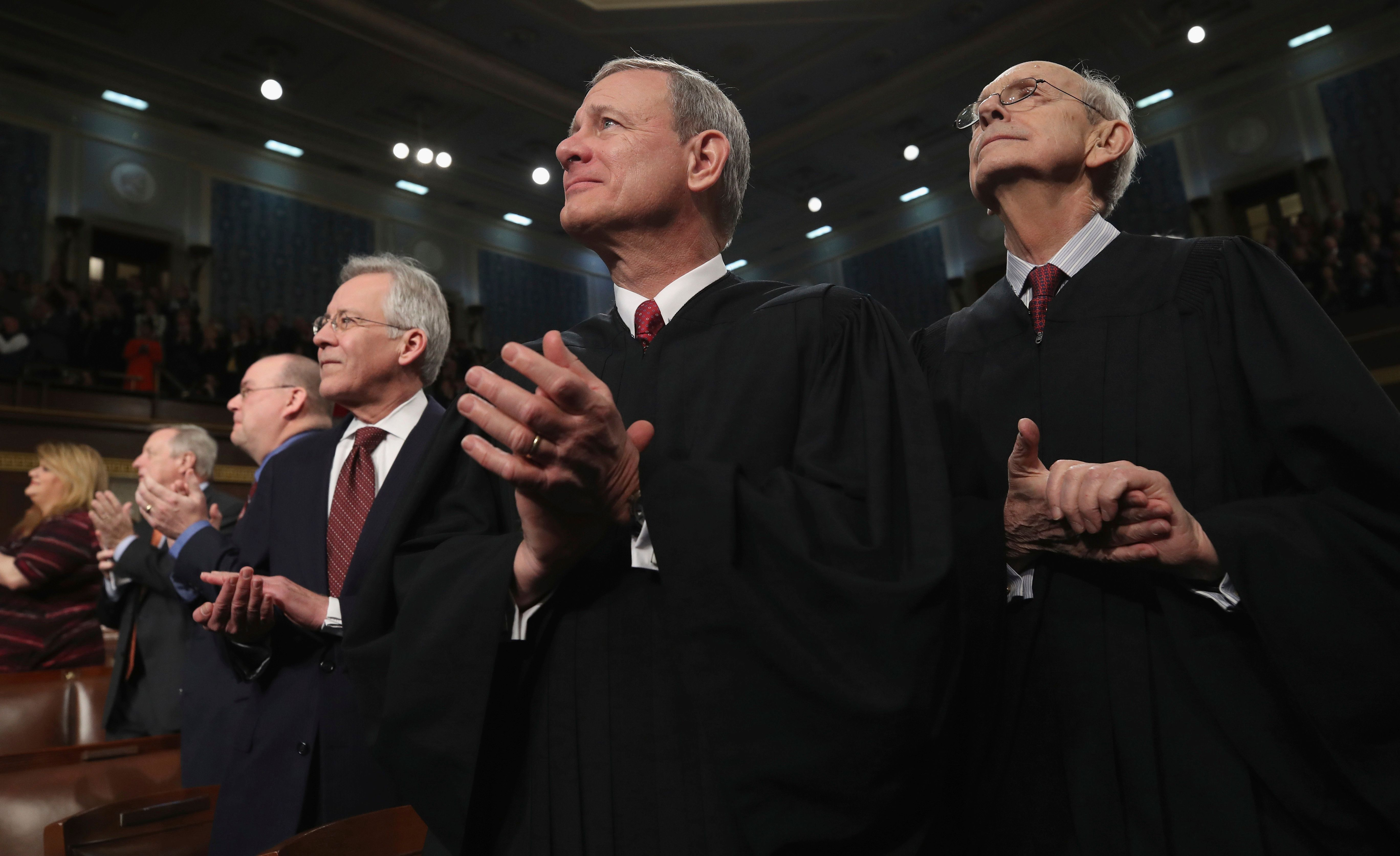U.S. Supreme Court Chief Justice John G. Roberts, center, and Associate Justice Stephen G. Breyer listen to President Donald Trump's State of the Union address to a joint session of Congress on Capitol Hill in Washington, Tuesday, Jan. 30, 2018. (Win McNamee/Pool via AP)