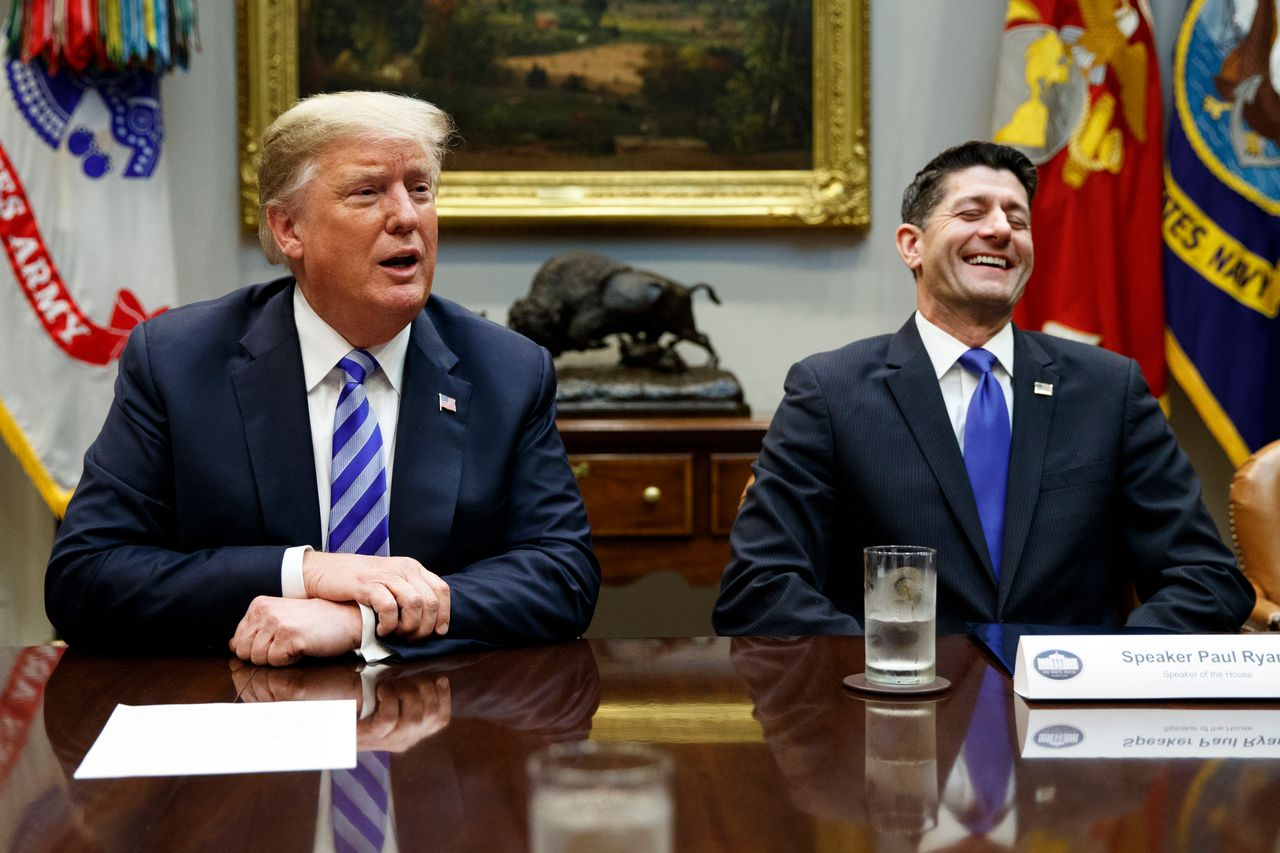 Speaker of the House Paul Ryan (R-Wis.) laughs as he listens to President Donald Trump speak during a meeting with Republican lawmakers at the White House on Sept. 5.