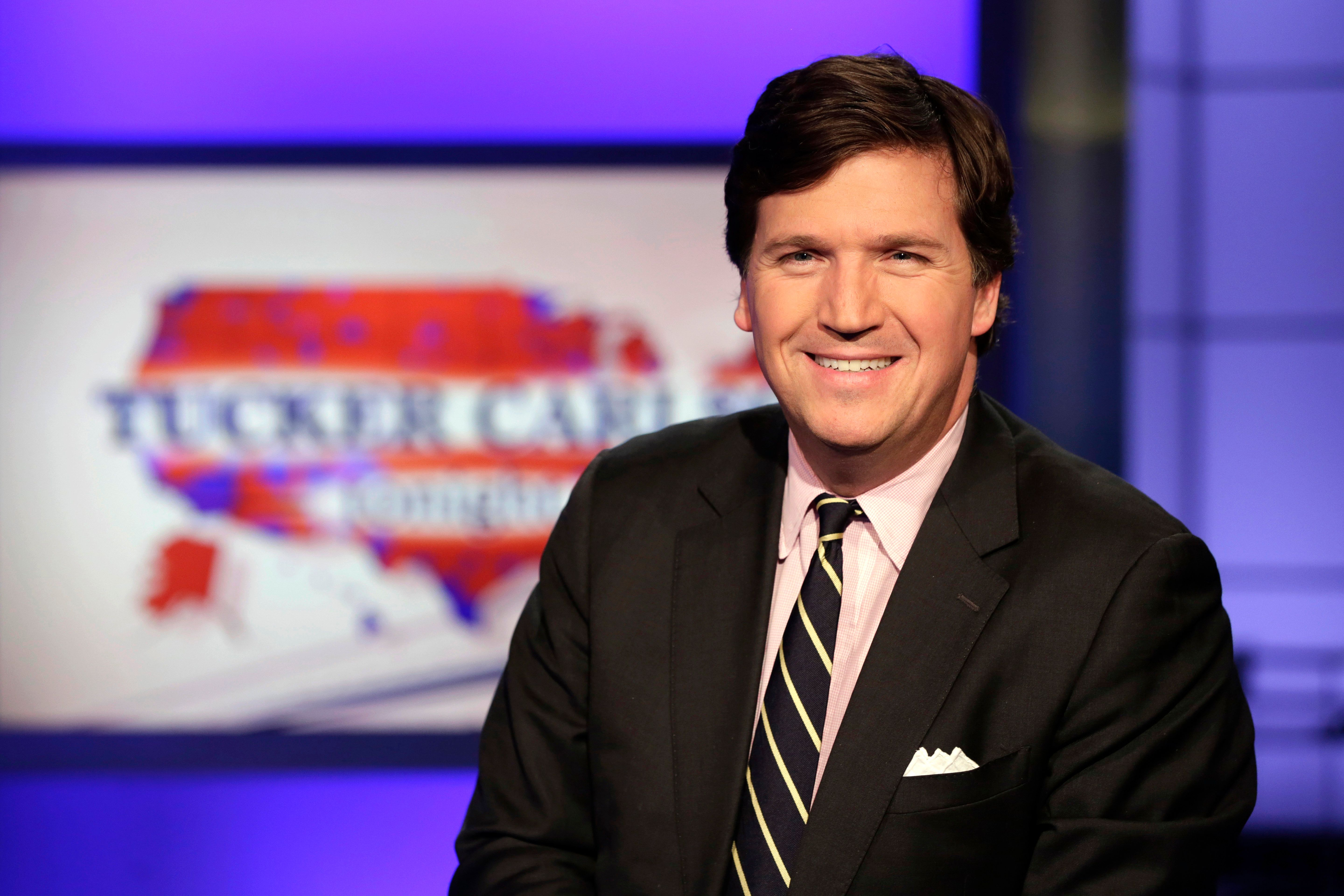 """Tucker Carlson, host of """"Tucker Carlson Tonight,"""" poses for photos in a Fox News Channel studio, in New York, Thursday, March 2, 2107. (AP Photo/Richard Drew)"""