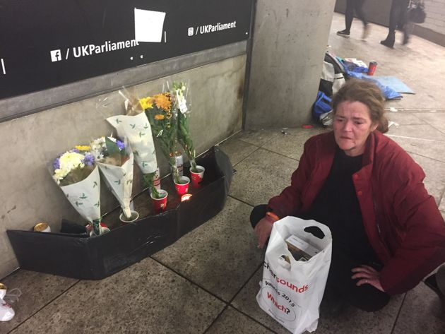 Homeless woman Jamie Leigh sits by a shrine to her friend who died just metres from the entrance to Westminster...