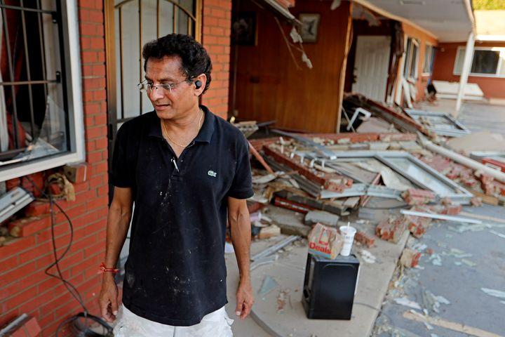 Kishor Depani sorts through damage at the motel he co-ownsin Spring Lake, North Carolina, after flooding from Hurricane
