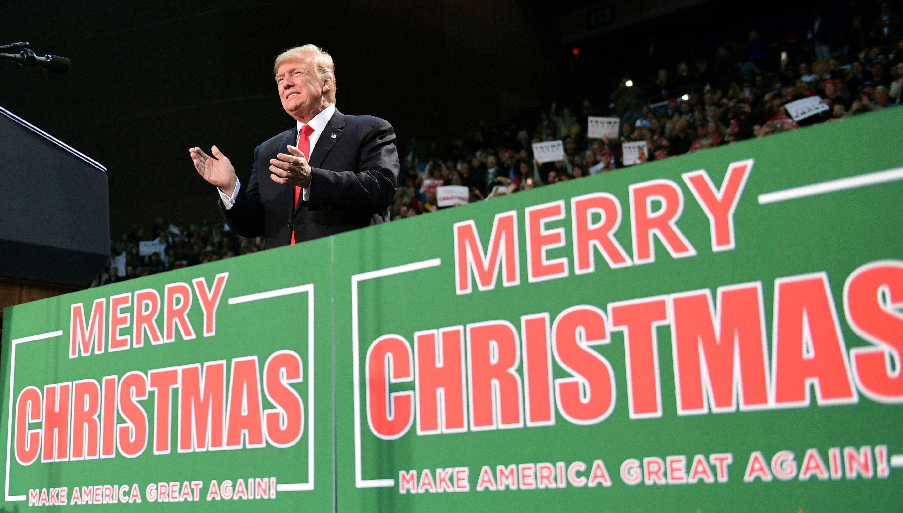"FILE - In this Dec. 8, 2017, file photo, President Donald Trump takes to the stage at a campaign-style rally at the Pensacola Bay Center, in Pensacola, Fla. There's no mistaking Trump's ""Merry Christmas"" message _ he wields it as a weapon against political correctness. For weeks, he's been liberally sprinkling his public remarks with Christmas tidings.  (AP Photo/Susan Walsh, File)"