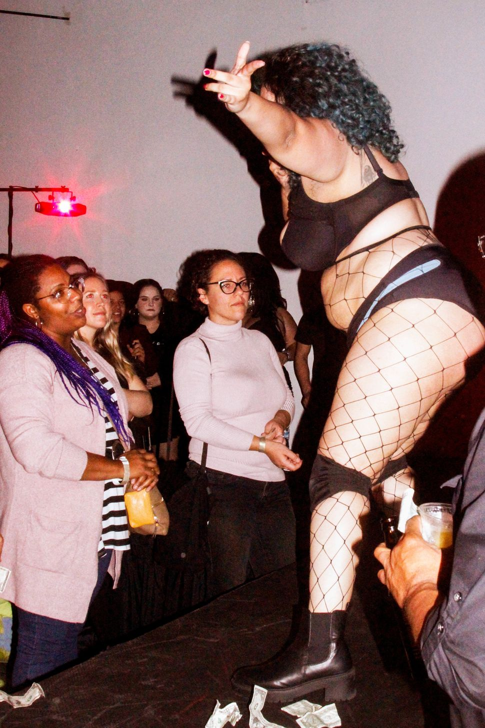 Vanessa Gritton dances for her audience during Thicc Strip.