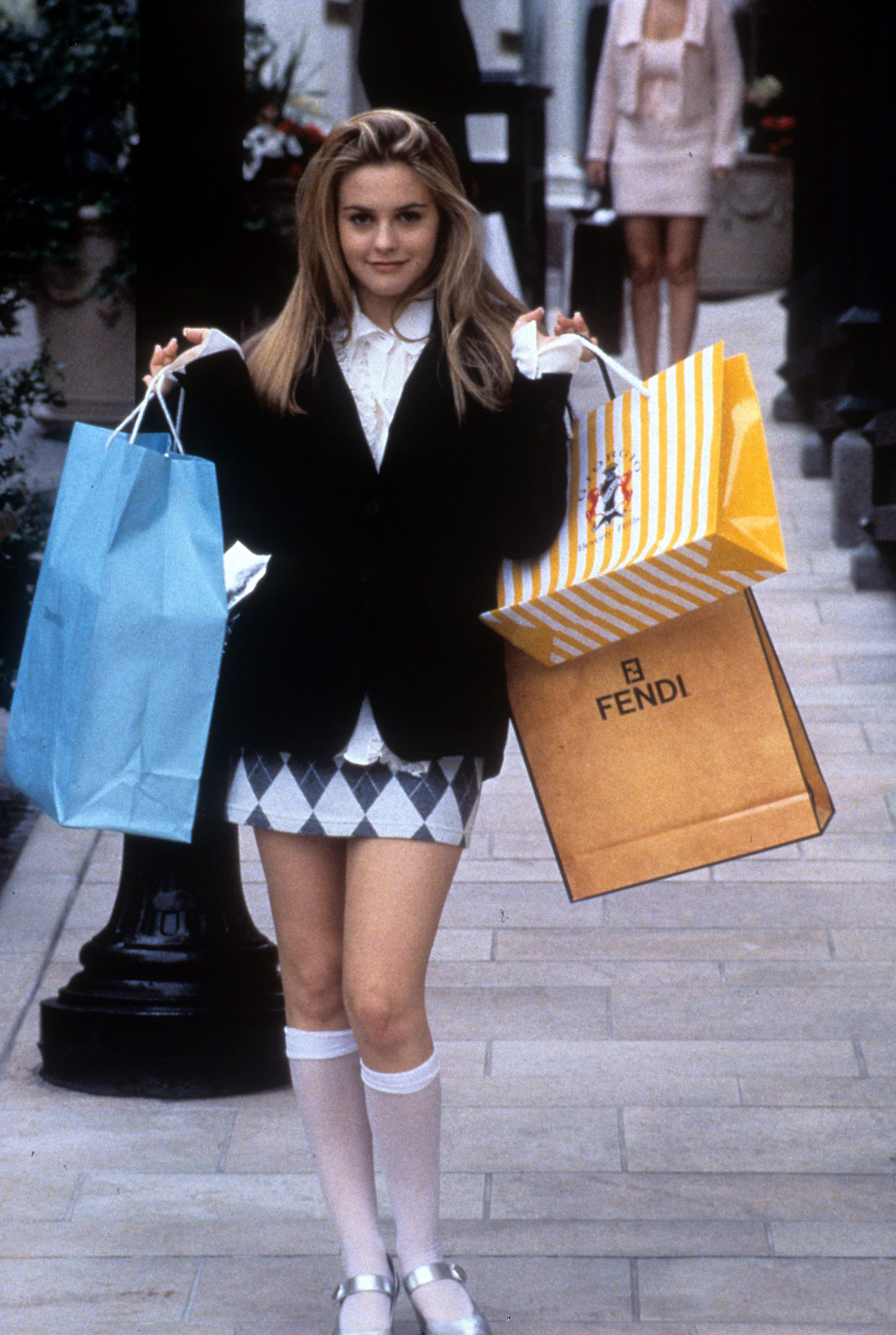 Alicia Silverstone holding shopping bags in a scene from the film 'Clueless', 1995. (Photo by Paramount Pictures/Getty Images)