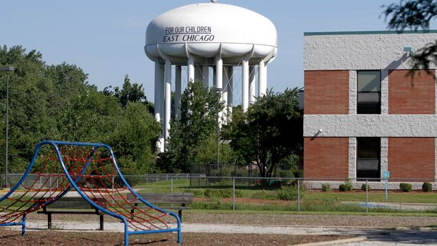 This Aug. 23, 2016 photo shows an empty playground and Carrie Gosch elementary school which has been closed due to lead contamination near the West Calumet Housing Complex in East Chicago, Ind. The mayor of this industrial town ordered the evacuation of the 40-year-old public housing complex this summer because of severe lead contamination, forcing more than 1,000 people from their homes. (AP Photo/Tae-Gyun Kim)