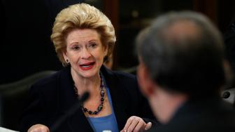 Sen. Debbie Stabenow, D-Mich., ranking member of the Senate Agriculture Committee, left, speaks during a meeting of the committee to consider a bipartisan farm bill that makes mostly modest adjustments to existing programs and, unlike the House version of the bill, doesn't pick a fight over food stamps, on Capitol Hill in Washington, Wednesday, June 13, 2018. The House version of the farm bill failed on the floor when a group of conservative lawmakers blocked its passage over an unrelated immigration bill. (AP Photo/Jacquelyn Martin)