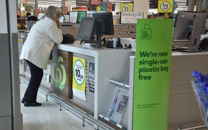 A sign, seen in a Woolworths supermarket, advises its customers that the store is plastic-bag free in Sydney on July 2, 2018.