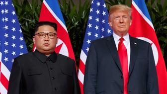 FILE - In this June. 12, 2018, file photo, U.S. President Donald Trump meets with North Korean leader Kim Jong Un on Sentosa Island, in Singapore. President Donald Trump had previously condemned the cruelty of North Korea's government, but after his historic summit on Tuesday with North Korean leader Kim Jong Un, Trump seemed to play down the severity of human rights violations in North Korea. (AP Photo/Evan Vucci, File)