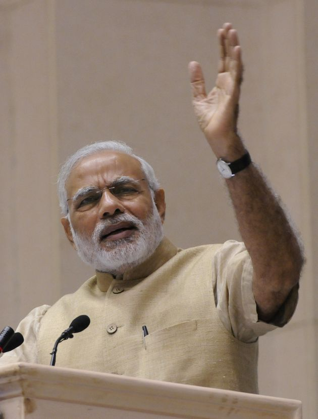 Prime Minister Narendra Modi gestures during his speech at the 10th annual Convention of the Central...