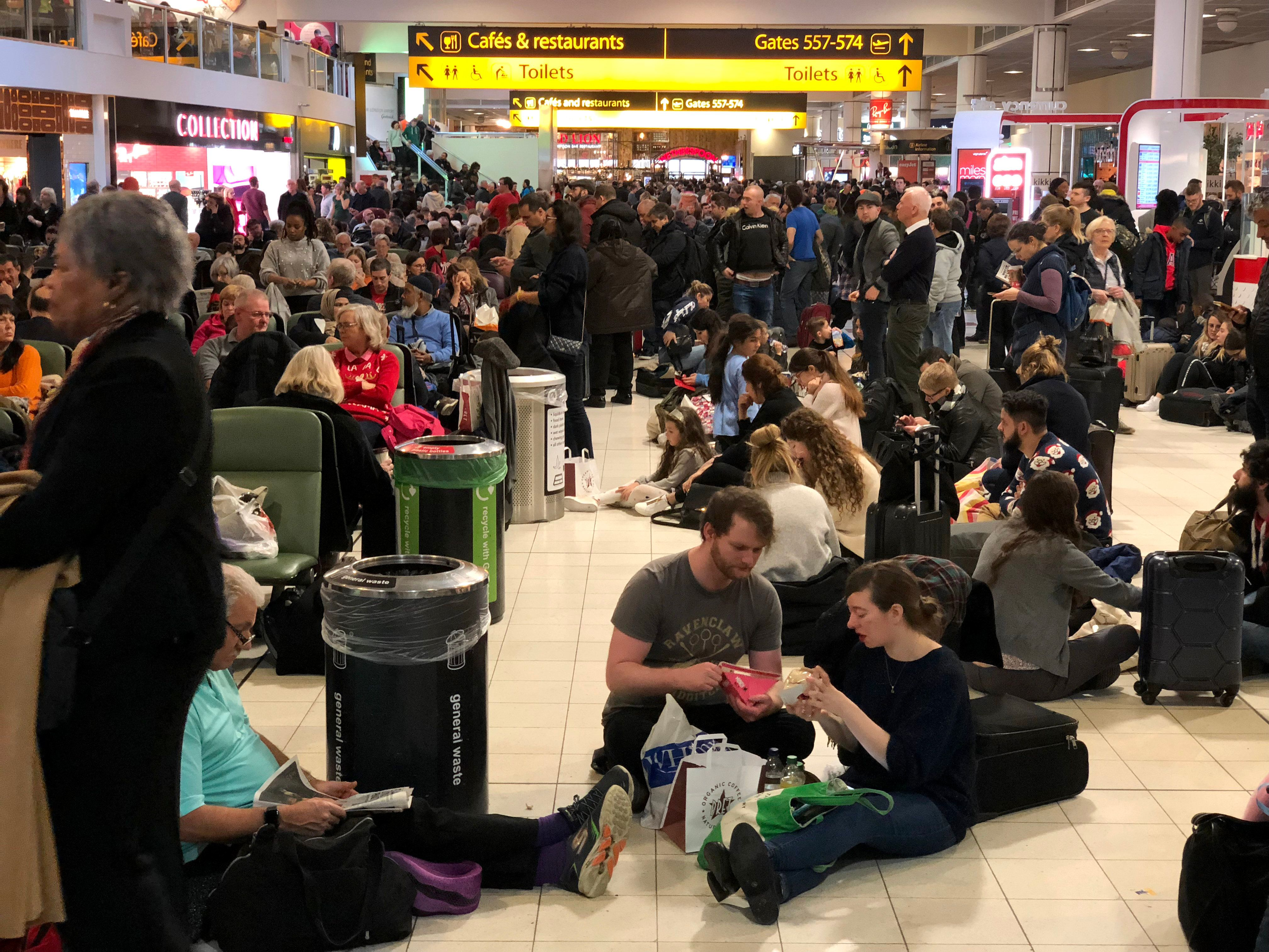 LONDON, ENGLAND - DECEMBER 20 : Passengers stranded at Gatwick waited for updates on their travel options on December 20, 2018 in London, England.  Authorities at Gatwick closed the runaway after Drones were spotted over the airport on the night of December 19. The shutdown has sparked a succession of delays and diversions in the run up to the Christmas getaway. (Photo by Athanasios Gioumpasis/Getty Images)