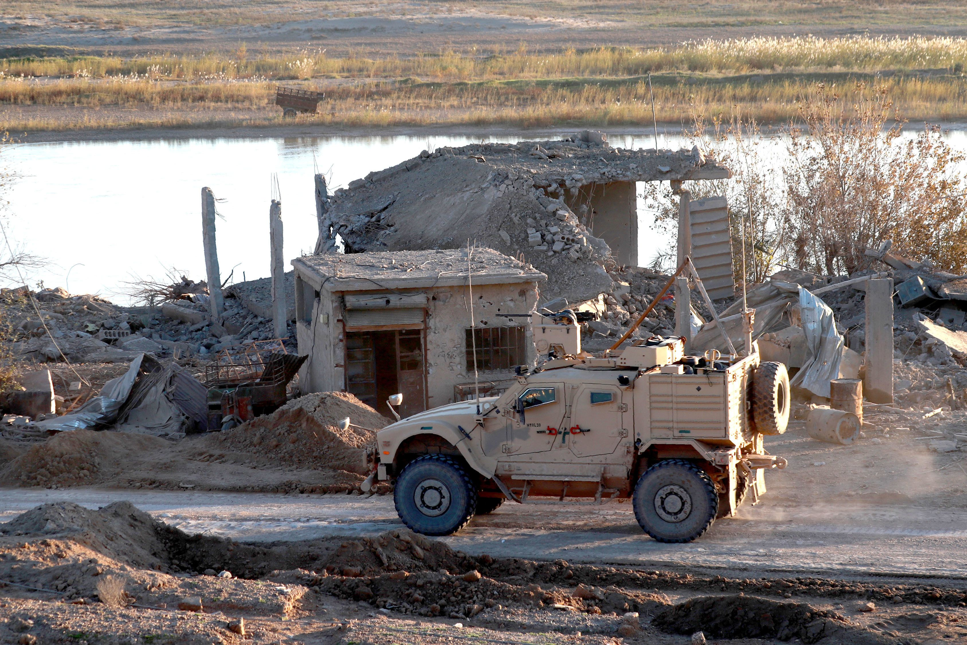 A U.S. army vehicle supports the Syrian Democratic Forces (SDF) in Hajin, in the Deir Ezzor province, eastern Syria, on Dec.1