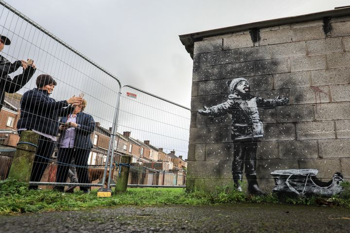 From one side, the new Banksy mural looks like a child playing in snow.