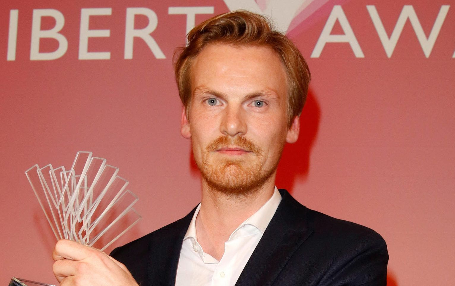 German journalist Claas Relotius holds his award trophy of the Reemtsma Liberty Award, a German journalist award, in Berlin, Germany, 22 March 2017.