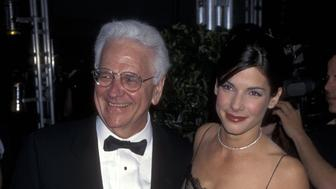 Actress Sandra Bullock and dad John Bullock attend the 22nd Annual People's Choice Awards on March 10, 1996 at Universal Studios in Universal City, California. (Photo by Ron Galella, Ltd./WireImage)
