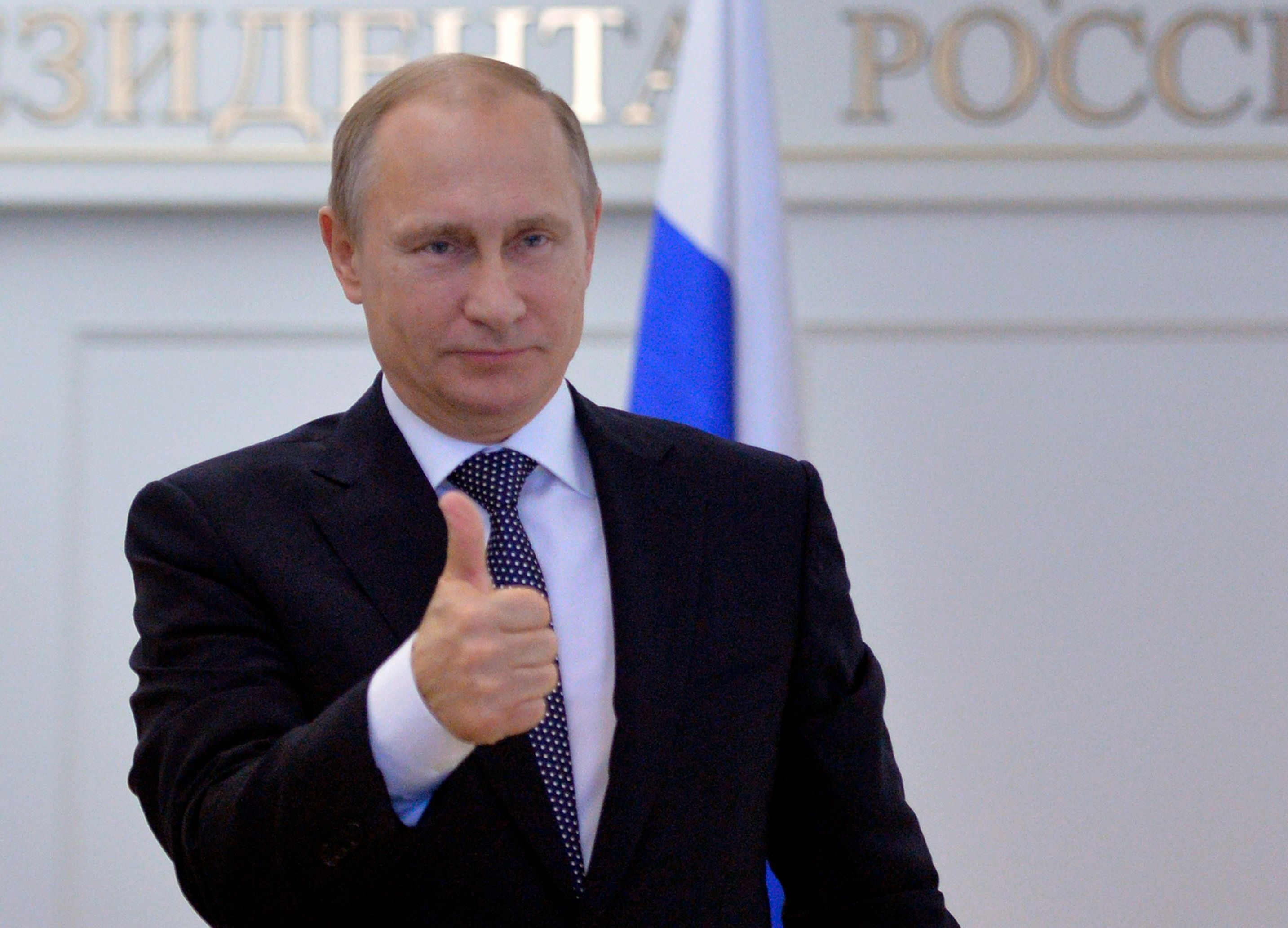 Russian President Vladimir Putin gives thumbs up during a live video link with Plesetsk Cosmodrome, as he watches a launch of Angara-A5 rocket booster in Moscow, Russia, on Tuesday, Dec. 23, 2014. (AP Photo/RIA Novosti, Alexei Druzhinin, Presidential Press Service)