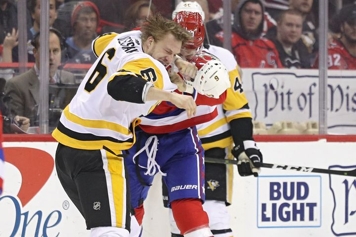 Tom Wilson of Washington fights Jamie Oleksiak of Pittsburgh in an NHL game on Wednesday.