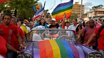 TOPSHOT - Mariela Castro (C), daughter of Cuban former President Raul Castro and the director of the National Center for Sex Education (CENESEX), participates in the gay pride parade during the celebration of the day against homophobia and transphobia in Havana, on May 12, 2018. (Photo by YAMIL LAGE / AFP)        (Photo credit should read YAMIL LAGE/AFP/Getty Images)