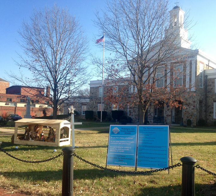 "A 2017 photo shows the Shenandoah Area Secular Humanists' ""Ten Commitments"" sign on the lawn of the courthouse in Front Royal"