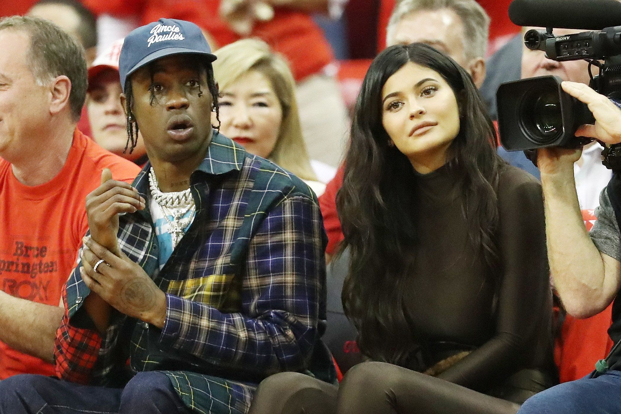 Travis Scott and Kylie Jenner sit courtside at the  2018 NBA Playoffs in May.