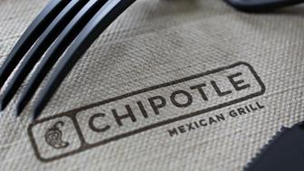 Chipotle Mexican Grill Inc. signage is seen on a napkin arranged for a photograph in Tiskilwa, Illinois, U.S., on Friday, April 22, 2016. Chipotle Mexican Grill Inc. is expected to release earnings figures on April 26. Photographer: Daniel Acker/Bloomberg via Getty Images
