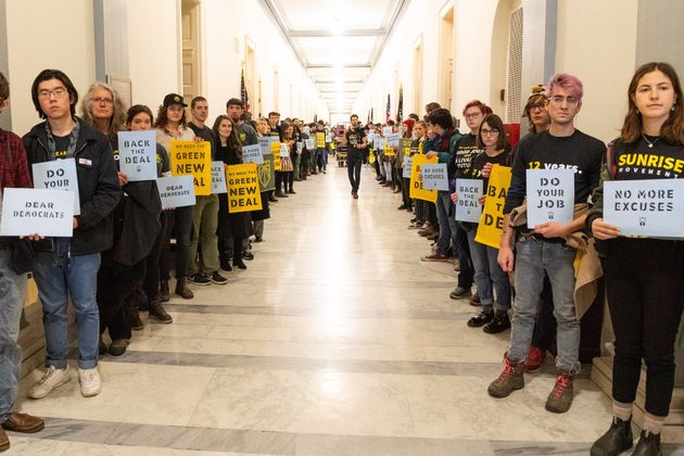 Sunrise Movement protesters inside the office of House Minority Leader Nancy Pelosi (D-Calif.) on Dec....