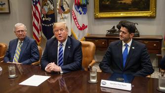US President Donald Trump speaks to the press with US Senate Majority Leader Mitch McConnell (L) and House Speaker Paul Ryan (R) at the White House in Washington, DC, on September 5, 2018. (Photo by NICHOLAS KAMM / AFP)        (Photo credit should read NICHOLAS KAMM/AFP/Getty Images)