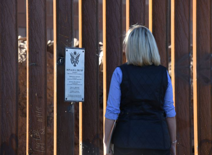 Homeland Security Secretary Kirstjen Nielsen looks at a newly renovated section of the 30-foot border fence in the El Centro