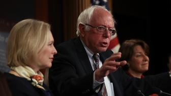 WASHINGTON, DC - MARCH 14:  U.S. Sen. Bernie Sanders (C) (I-VT) speaks as Sen. Kirsten Gillibrand (L) (D-NY) and Sen. Amy Klobuchar (R) (D-MN) look on during a news conference at the U.S. Capitol on March 14, 2017 in Washington, DC. Senate Democrats annouced legislation to ensure American workers receive paid medical and family leave.  (Photo by Justin Sullivan/Getty Images)
