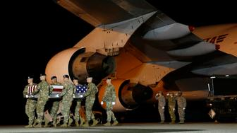 In this Nov. 26, 2018, photo, a U.S. Army carry team moves a transfer case containing the remains of Sgt. Leandro A. Jasso, at Dover Air Force Base, Del. A rash of American combat deaths in Afghanistan puts a spotlight on a stalemated 17-year war that is testing President Donald Trump's commitment to pursuing peace with the Taliban. (AP Photo/Patrick Semansky)