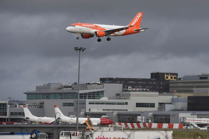 An easyJet plane descends towards Gatwick's runway on Friday after the airport reopened.