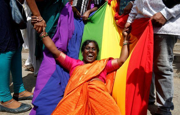 An activist of the lGBT community celebrates after the Supreme Court's verdict of decriminalizing gay...