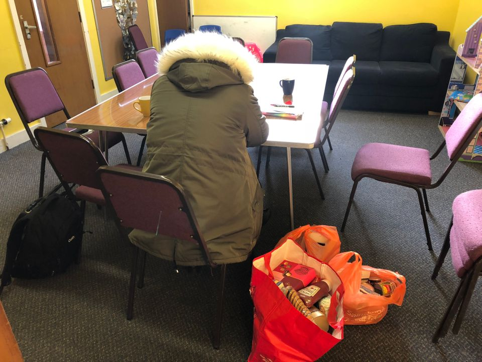 Joanne collects an emergency food parcel from her local foodbank in