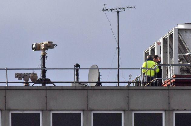 Counter-drone equipment is seen on a roof at Gatwick Airport as a police hunt for a suspect