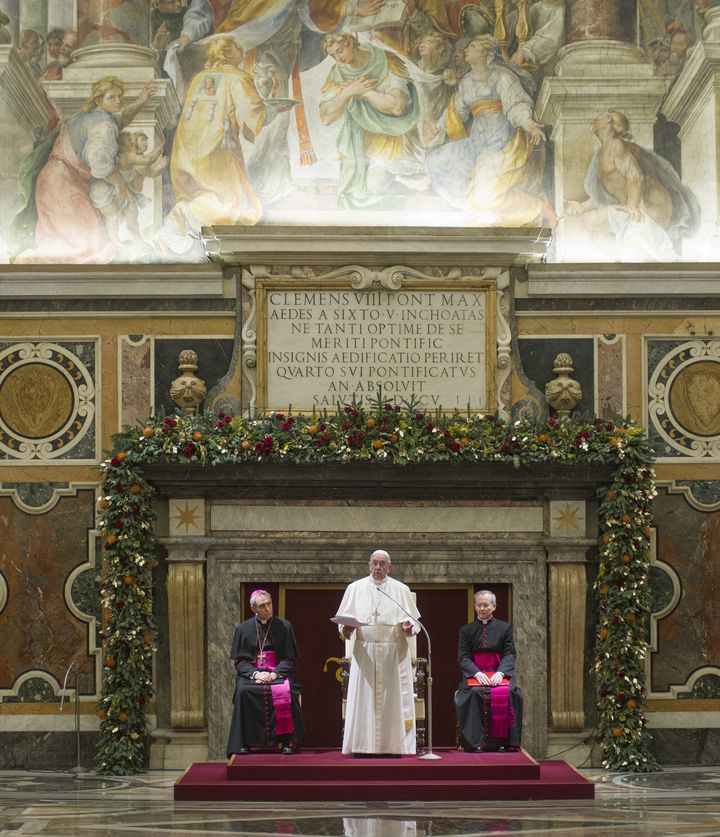 Pope Francis and the Roman Curia during the Christmas greetings at Clementine Hall in Vatican City on Friday. The pope addres