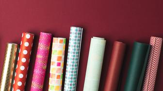 flat lay with arranged colorful rolls of wrapping paper on tabletop