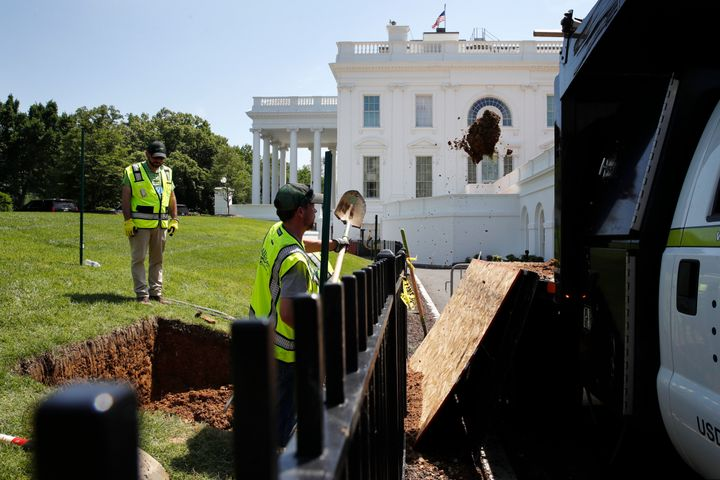 Workers fix a sinkhole on the grounds of the White House in May.