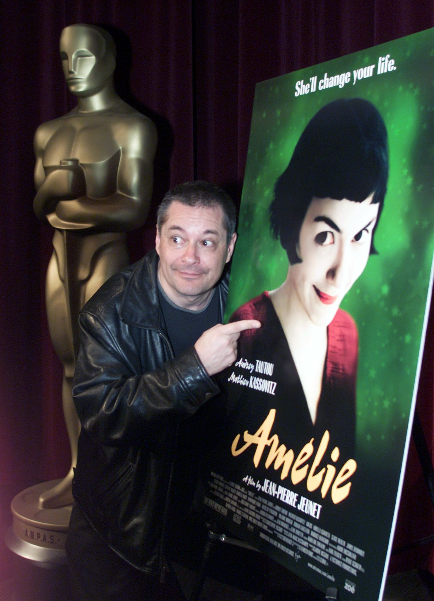 "Jean-Pierre Jeunet, director of the Academy Award-nominated foreign language film ""Amelie,"" poses with a poster for the movie at the Motion Picture Academy in Beverly Hills, California March 22, 2002.  ""Amelie"" is one of five films nominated for a best foreign language Oscar."