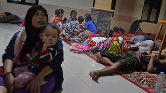 Residents sit inside a mosque as they evacuated following high waves and the eruption of Anak Krakatau volcano at Labuan district in Pandeglang regency, Banten province, Indonesia, December 22, 2018, in this photo taken by Antara Foto. Picture taken December 22, 2018. Antara Foto/Muhammad Bagus Khoirunas/ via REUTERS ATTENTION EDITORS - THIS IMAGE WAS PROVIDED BY A THIRD PARTY. MANDATORY CREDIT. INDONESIA OUT.