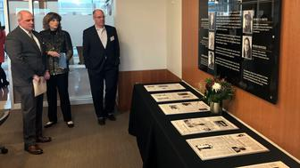 From left, Trif Alatzas, publisher and editor in chief of Baltimore Sun Media; Lucy Dalglish, Phillip Merrill College of Journalism dean; Timothy Knight, president of Tribune Publishing Company, look over a memorial, Tuesday, Dec. 11, 2018, at the University of Maryland's journalism school in College Park, Md., dedicated  to the five Capital Gazette employees who were shot and killed in an attack on the Annapolis newspaper's office. (AP Photo/Michael Kunzelman)