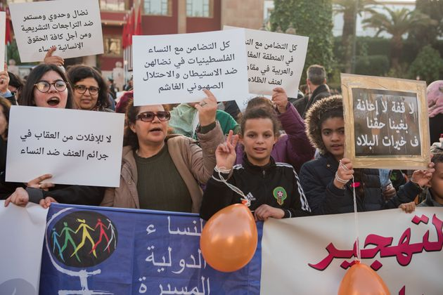 RABAT, MOROCCO - MARCH 08: Women hold banners during a protest on 'violence against women' regarding...