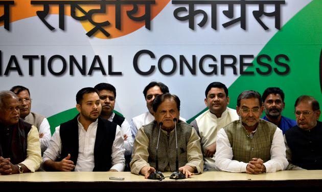 Congress leader Ahmed Patel speaks to media as RJD leader Tejashwi Yadav, Hindustani Awam Morcha (Secular)...