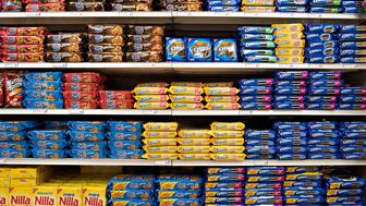 Mondelez International, Inc. cookie products including Oreo, Chips Ahoy, and Nilla brands sit on a supermarket shelf in Princeton, Illinois, U.S., on Wednesday, April 1, 2015. The looming merger of Kraft Foods Group Inc. and H.J. Heinz is ratcheting up the pressure on other foodmakers to shape up or seek deals of their own. Photographer: Daniel Acker/Bloomberg via Getty Images