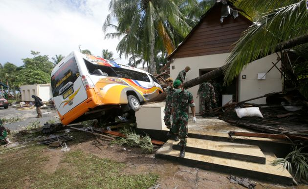 Indonesian soldiers search the Tanjung Lesung beach resort in Indonesia for survivors on