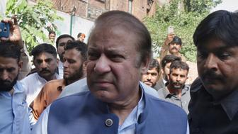 Pakistan's former prime minister Nawaz Sharif arrives to appear in a court in Lahore, Pakistan, Monday, Oct. 8, 2018. Sharif is in court again, this time on treason charges for comments he made earlier this year, claiming militants had crossed from Pakistan into India to carry out the deadly 2008 Mumbai terror attacks. (AP Photo/K.M. Chaudary)