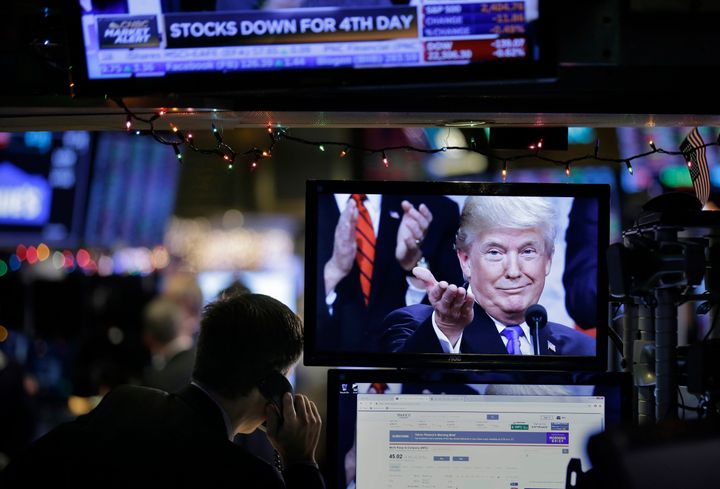 A picture of President Donald Trump is displayed on a computer on the floor of the New York Stock Exchange in New York, Monda