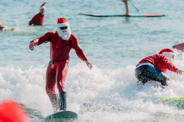 600 Surfing Santas Make A Big Splash In Cocoa Beach,