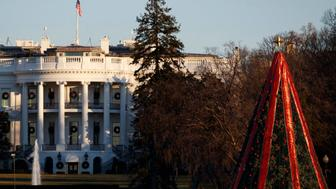 The White House and the National Christmas Tree are seen in Washington, Sunday, Dec. 23, 2018. The federal government is expected to remain partially closed past Christmas Day in a protracted standoff over President Donald Trump's demand for money to build a border wall with Mexico. (AP Photo/Carolyn Kaster)