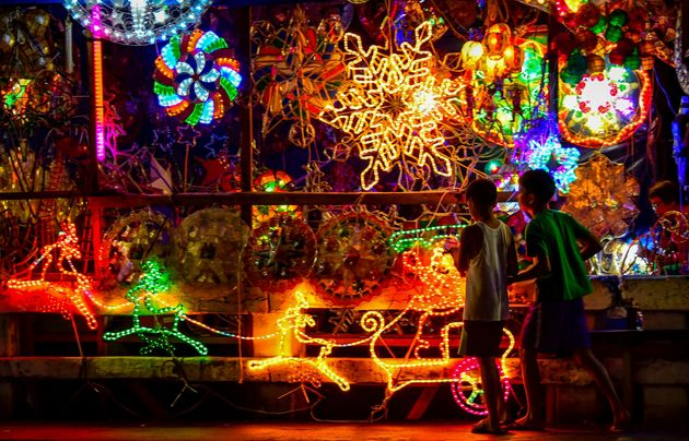 Christmas lanterns, known locally as 'parol', on display along a street in Manila. Parol are star-shaped...