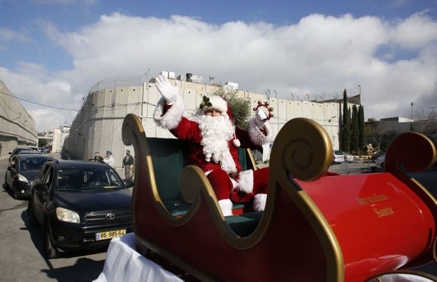 A Santa Claus on his sleigh as he arrives in the West Bank city of Bethlehem. It was believed to...