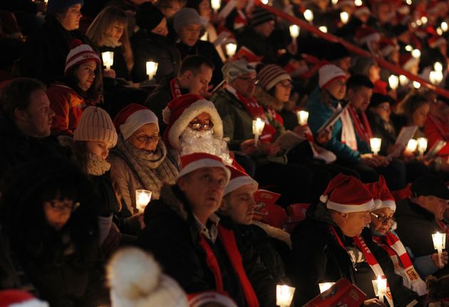 Fans of the FC Union football club gather in the club's stadium to sing Christmas carols in Berlin, Germany....